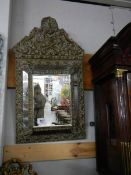 A metal framed bevel edged mirror. ****Condition report**** Late 19th century.