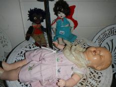 Two old collector's dolls and a golly.