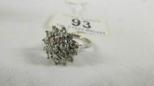 A 18ct floral diamond ring of 1.5 carats, size L half.