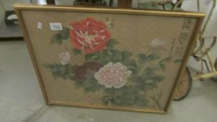 A signed framed and glazed Chinese floral picture.