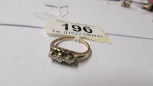 A 9ct gold and small diamond ring, size M.