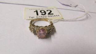 A 9ct gold and pink stone dress ring, size N.