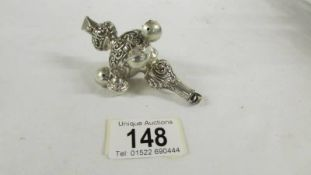 A silver 1903 babies rattle with whistle.