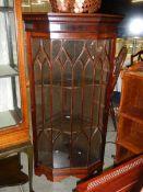 A mahogany astragal glazed corner cabinet.