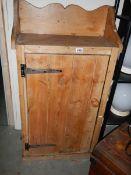 An old pine single door cupboard.