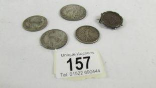 A 1933 twenty franc coin, 2 ten franc coins 1930 & 1936,