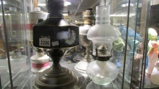 Four old oil lamp bases.