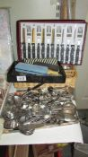 A large quantity of assorted cutlery.