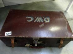 A vintage suitcase with painted D.W.C.