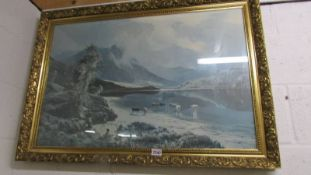 A large gilt framed rural print with cattle.