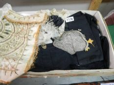 A box of miscellaneous vintage items including clergymen's items, bonnet,