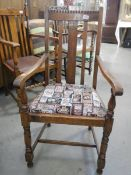 A 1930's oak carver chair