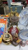 A mixed lot of brass ware including candlesticks.
