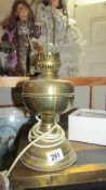 A brass table lamp.