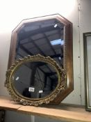 An octagon wooden framed mirror and an oval gilt framed mirror,
