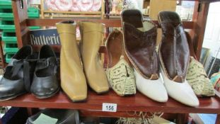 A shelf of vintage boots and shoes,