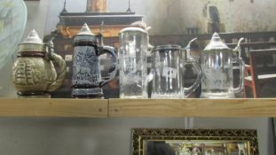 3 glass beer steins and 2 ceramic beer steins.