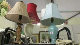 4 assorted table lamps.