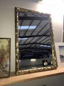 An ornate gilt framed mirror 72cm x 49cm approx.