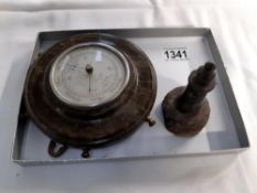A Cornish seprentine ships wheel barometer and a lighthouse