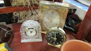 A glass clock and 2 others.