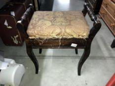 A vintage piano stool