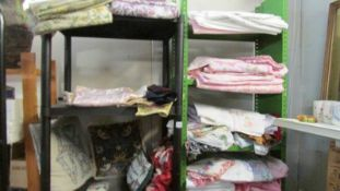 A large quantity of textiles including bed linen, curtains, cushions etc.