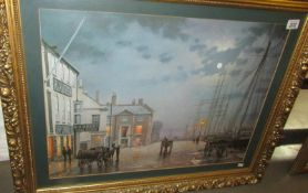 A gilt framed harbour scene.