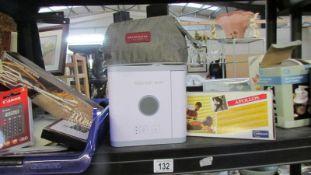 A shelf of miscellaneous items including calculators, air purifier etc.