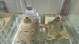 3 early 20th century cast iron oil lamp bases.