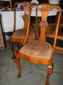 A pair of Edwardian dining chairs on Queen Anne legs