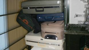Five travel bags and cases.