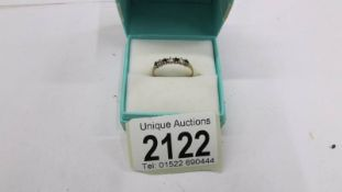 A 9ct gold ring, size N.