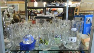 A mixed lot of drinking glasses.