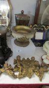 A lidded urn, a decorated urn and 3 wall cherubs.
