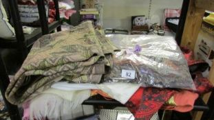 A mixed lot of textiles including scarves.