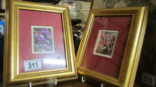 A pair of gilt framed and glazed floral studies.
