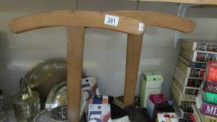 A pair of vintage coat hangers.