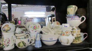 A shelf of assorted ceramics including jugs, dishes etc.