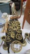 A mixed lot of horse brasses etc.