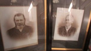 A pair of old framed and glazed photographs.