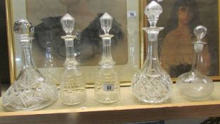A pair of cut glass decanters and 3 others.