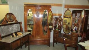 A Victorian mahogany three piece bedroom suite comprising triple mirror dressing table,