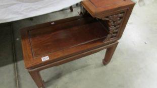 A teak Chinese style telephone seat.