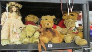 6 Teddy bears and a porcelain collector's doll.