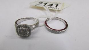 A matching set of 2 white gold and diamond rings, size M.