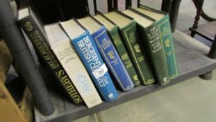 A quantity of antique reference books.