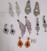 6 pairs of sparkly pendant earrings.