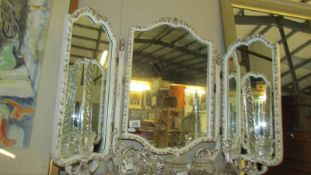 A triple dressing table mirror.