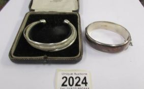 2 hall marked silver bangles.
